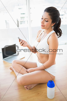Fit woman sending a text