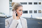 Thoughtful stylish businesswoman having a phone call