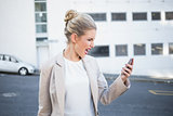Furious stylish businesswoman shouting at her phone