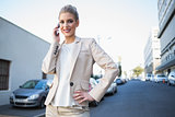 Cheerful elegant businesswoman on the phone