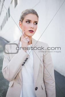 Thoughtful attractive businesswoman posing