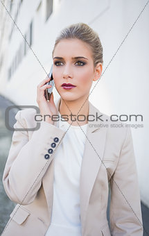 Thoughtful attractive businesswoman on the phone