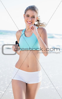 Cheerful sporty blonde in sportswear jogging