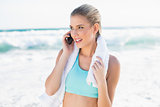 Cheerful fit blonde in sportswear on the phone