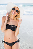 Attractive blonde in elegant black bikini smiling at camera