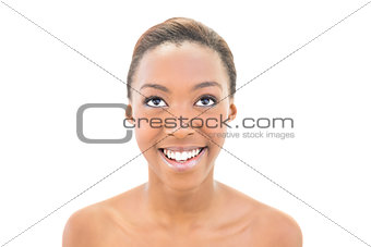 Portrait of smiling natural beauty looking up