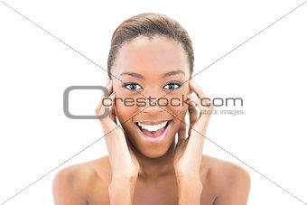 Smiling beautiful model touching her cheeks