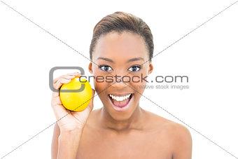 Smiling beautiful model holding orange