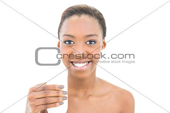 Beautiful smiling model holding glass of milk