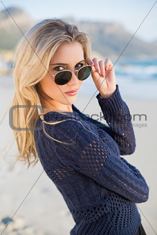 Attractive casual blonde looking over her sunglasses