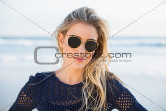 Cheerful sensual blonde posing