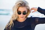 Gorgeous sensual blonde looking over her sunglasses