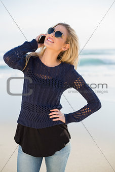 Smiling gorgeous blonde on the phone