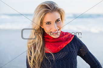 Cheerful gorgeous blonde with red scarf posing