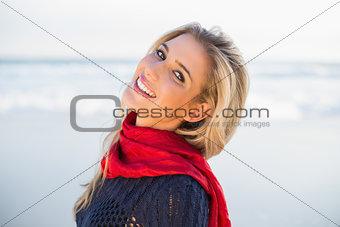Smiling sensual blonde posing