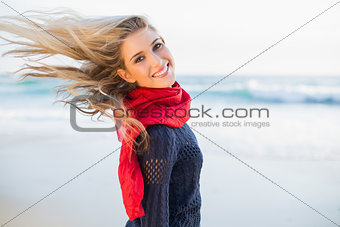 Cheerful sexy blonde tossing her hair