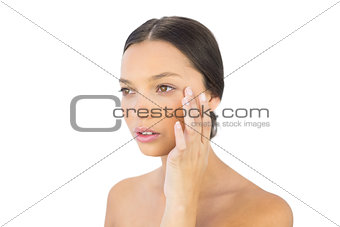 Attractive woman holding hand on face