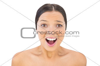 Brunette woman screaming at camera