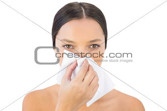 Gorgeous woman blowing her nose