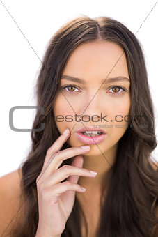 Attractive bown haired woman posing looking at camera