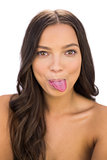 Happy woman stick her tongue out