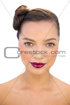 Attractive woman with red lips looking at camera