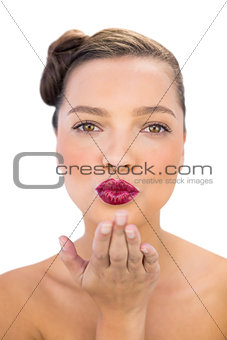 Attractive woman with red lips blowing air kiss
