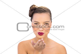 Pretty gorgeous woman with red lips blowing air kiss