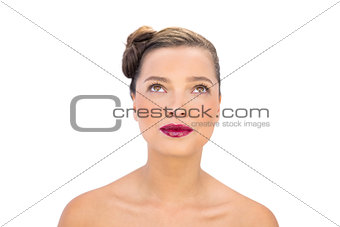 Attractive woman with red lips looking up