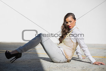 Attractive woman with red lips sitting