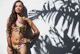 Relaxed gorgeous woman in flowery bikini posing