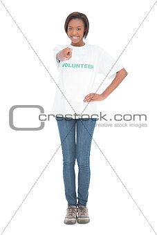 Smiling volunteer pointing straight