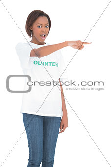 Surprised woman pointing at something