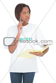 Thoughtful natural beauty holding notebook