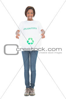 Nice volunteer holding recycling crate
