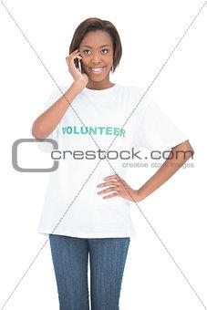 Cheerful pretty volunteer having a phone call
