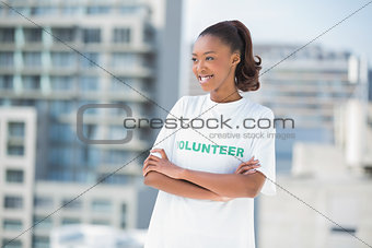 Smiling volunteer woman posing