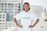 Serious woman with hands on hips wearing volunteer tshirt