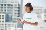 Woman wearing volunteer tshirt using tablet pc