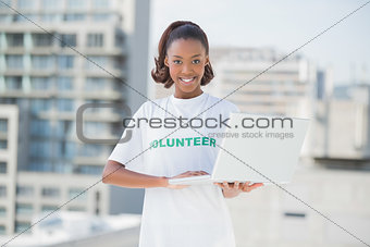 Cheerful volunteer smiling at camera