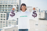 Smiling volunteer woman holding money bags