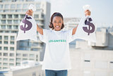 Happy volunteer woman holding money bags