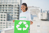 Happy altruist woman holding recycling sign