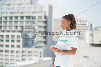 Pensive volunteer woman holding clipboard