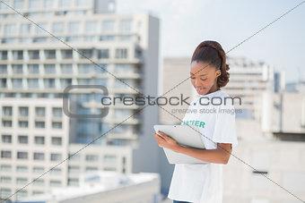 Focused volunteer holding clipboard