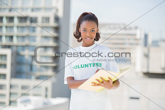 Happy altruist woman holding notebook