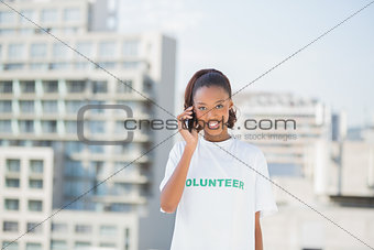 Cheerful altruist woman on the phone