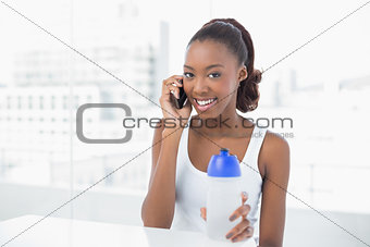 Attractive athletic woman having a phone call