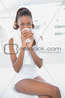 Attractive athletic woman holding coffee