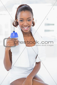 Attractive athletic woman holding flask